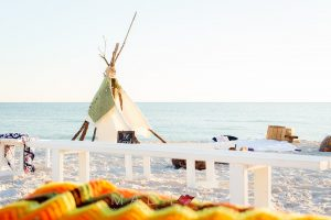 Beach side Bohemian bonfire setting by Ceremony Design Company. Photograph by Mad Love Weddings.